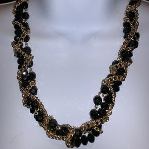 Black beaded gold tone necklace
